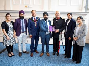 Slough Sikh charity accepts prestigious award from the Queen